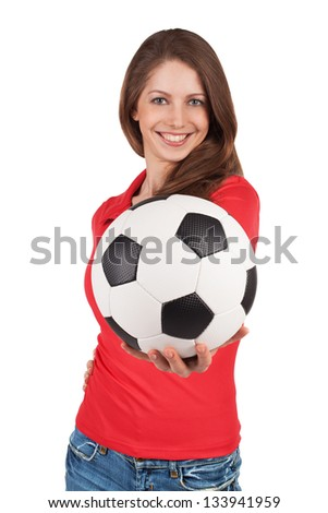 Smiling girl with a soccer Ball in hand - stock photo