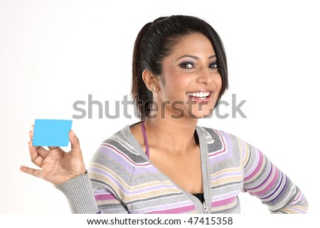Smiling girl with blue credit card - stock photo