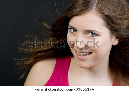 Smiling girl with braces - stock photo