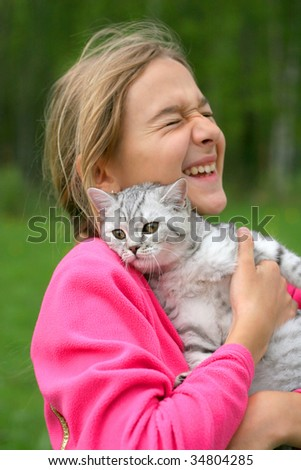 smiling girl with british cat - stock photo