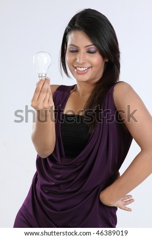 Smiling girl with bulb - stock photo