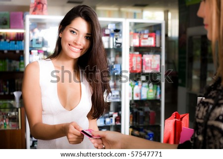 Smiling girl with card - stock photo