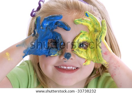 Smiling Girl with coloured hands after painting session - stock photo