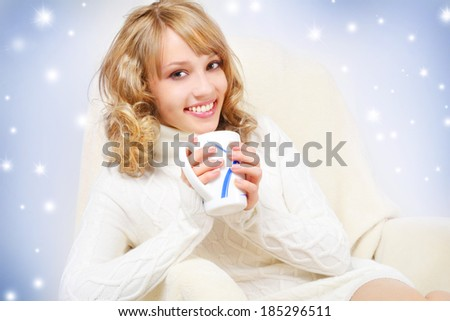 smiling girl with cup of tea. girl drinking tea on light background - stock photo