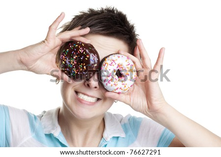 Smiling girl with donuts as eyes isolated on white - stock photo