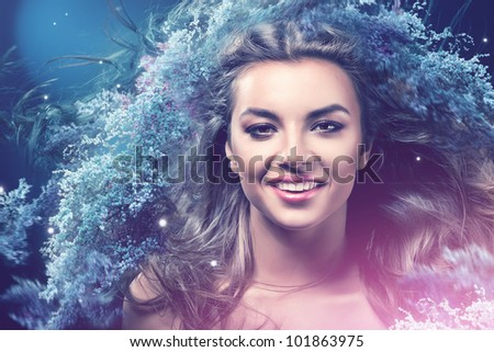 smiling girl with flowers in hair - stock photo