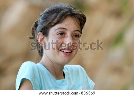 Smiling girl with freckles - stock photo
