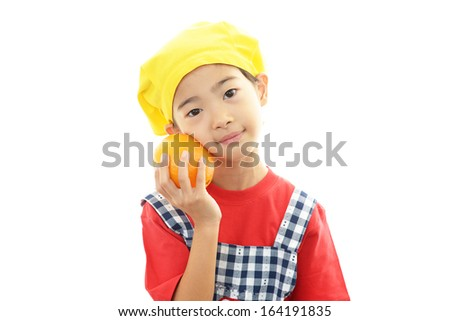 Smiling girl with fruit - stock photo