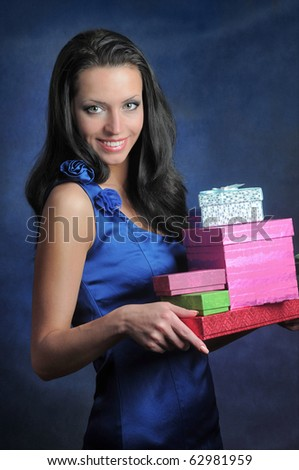 Smiling girl with gifts