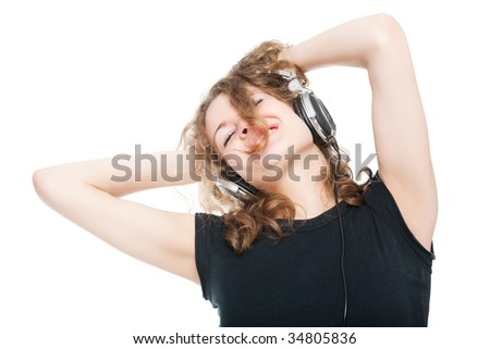 Smiling girl With Headphones Enjoying His Music - stock photo