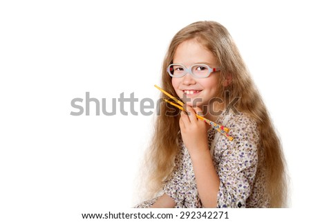smiling girl with Japanese chopsticks, with space for text - stock photo