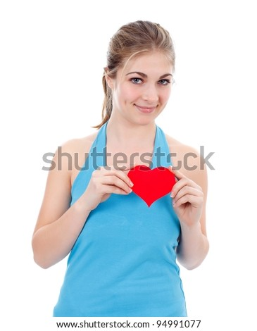 Smiling girl with little red paper heart in her hand - stock photo