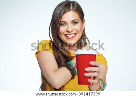 Smiling girl with long hair holding coffee cup. Isolated portrait.