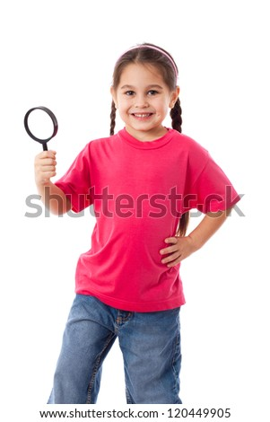 Smiling girl with magnifying glass, isolated on white - stock photo