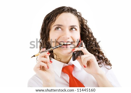 smiling girl with pen and mobile phone in hands - stock photo