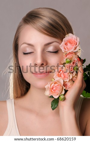 Smiling girl with roses