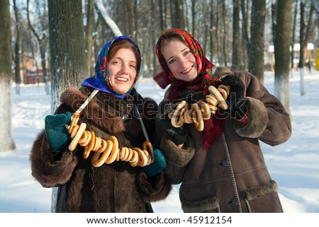 Smiling girl with round cracknel during Pancake Week at Russia - stock photo