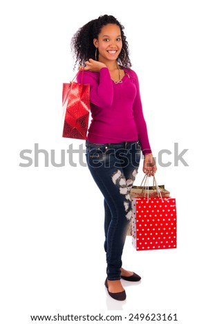 Smiling girl with shopping bags, isolated - stock photo