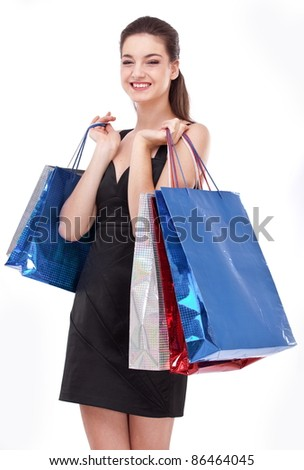 Smiling girl with shopping bags. Isolated on a white background. - stock photo