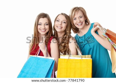 Smiling girl with shopping bags on white background - stock photo