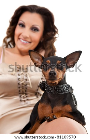 smiling girl with stylish miniature pincher, isolated on white background, dog in focus - stock photo