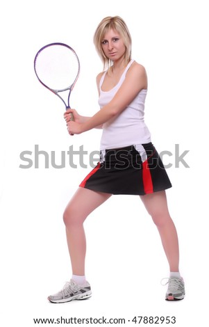 Smiling girl with tennis racket on white background - stock photo