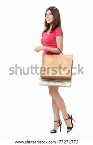 Smiling girl with the packages on a white background - stock photo