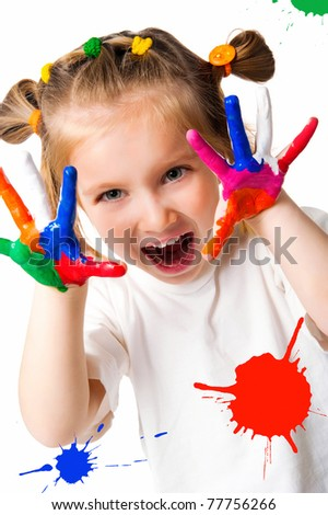 smiling girl with the palms painted by a paint. Isolated on white background - stock photo