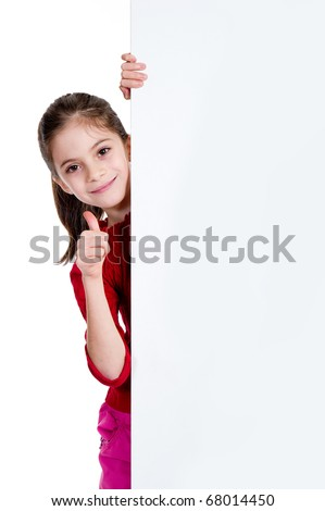 smiling girl with thumb up holding empty board - stock photo