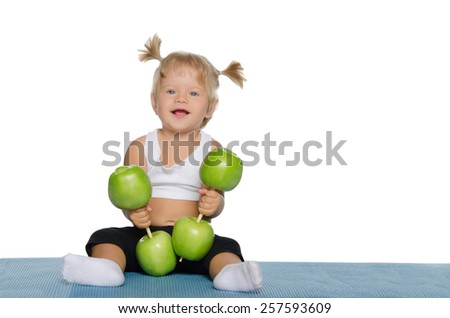 Smiling girl with weights of green apples isolated on white - stock photo