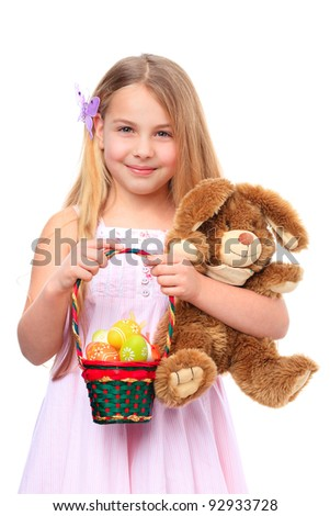smiling girl witha basket filled with easter eggs and cute easter bunny - stock photo