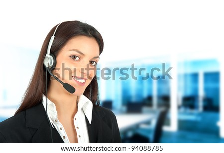Smiling girl works in a call center - stock photo