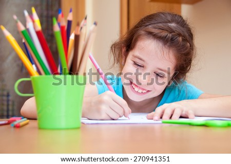 Smiling girl writing - stock photo