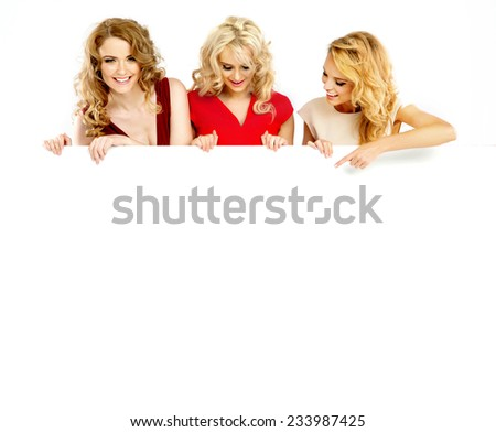 Smiling girls holding empty board