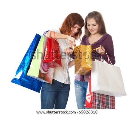 smiling girls with bright bags. Isolated on white background
