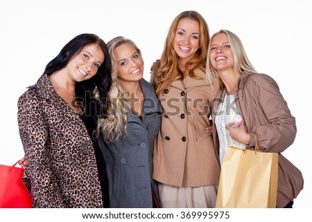 Smiling girls with shopping bags