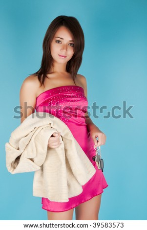 Smiling glamorous girl with fur coat and car key - stock photo