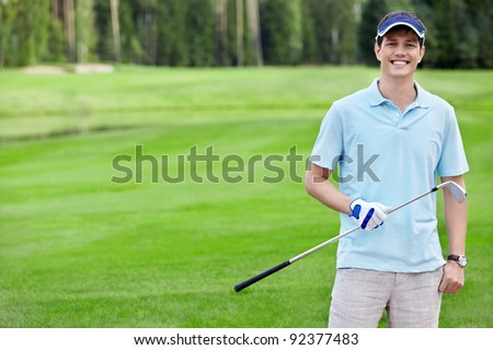 Smiling Golfer on the golf course - stock photo