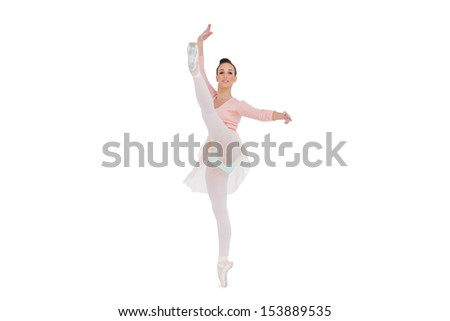Smiling gorgeous ballerina rising her leg on white background  - stock photo
