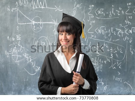 Smiling graduated student with blackboard on the background - stock photo