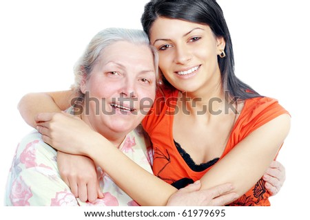 Smiling grandmother and granddaughter embracing,white background ,horizontal - stock photo