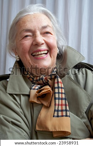 Smiling grandmother in the olive overcoat