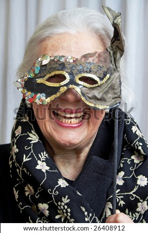 Smiling grandmother with mask - stock photo