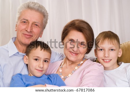 smiling grandparents with childrens on a white background