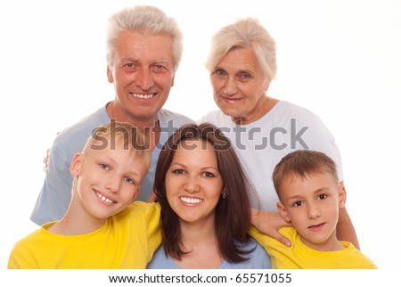 smiling grandparents with grandsons - stock photo
