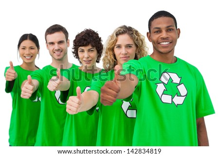 Smiling group of environmental activists giving thumbs up on white background - stock photo