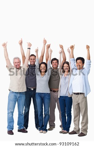 Smiling group of friends giving thumbs up against a white background - stock photo