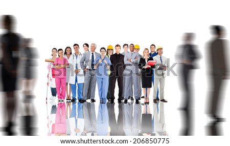 Smiling group of people with different jobs with silhouettes of business people - stock photo