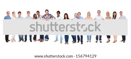 Smiling Group Of People With Placard Together Over White Background - stock photo