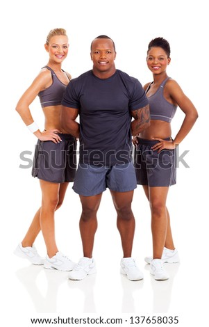 smiling group of personal trainers on white background - stock photo